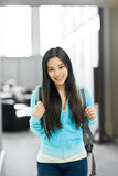 Asian college student. A portrait of an Asian college student in the library royalty free stock image