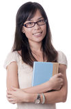 Asian College Student. An Asian college student carrying a big book on white background stock photos