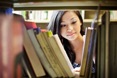 Asian college student. A portrait of an Asian college student in library Stock Image