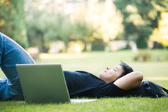 Asian college student. An asian college student lying down on the grass Stock Photos