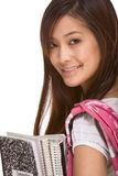 Asian college student with backpack and notebooks. Portrait of friendly Asian High school girl student with backpack, holding notebooks and composition book Royalty Free Stock Photos