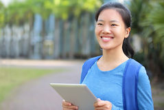 Asian college student with digital tablet Royalty Free Stock Photos