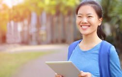 Asian college student with digital tablet Royalty Free Stock Image
