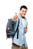 Asian college student happy thumbs up. Happy young Asian college student thumbs up Royalty Free Stock Photography