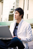 Asian college student and laptop Stock Image