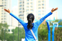 Asian college student. Open arms at the basketball court Stock Photo