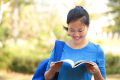 Asian college student reading book Stock Photo