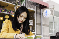 Asian college student reading outdoor Stock Photo