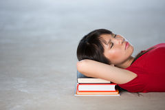 Asian College Student Sleeping on books Royalty Free Stock Photography