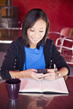 Asian college student texting stock photography
