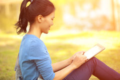 Asian college student use tablet pc Stock Image