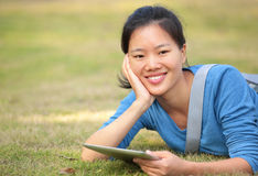 Asian college student use tablet pc. At campus royalty free stock images