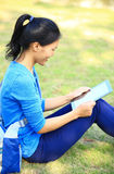 Asian college student use tablet pc Royalty Free Stock Photo