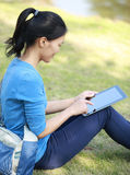 Asian college student use tablet pc Stock Images