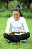 Asian college student use tablet pc Royalty Free Stock Photography