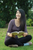 Asian college student. Asian woman college student on campus. She reading book in park Stock Image