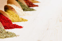 Asian colorful powder spices close up on white wooden board with copy space. Stock Images