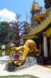 Asian colorful tiger statue at the entrance to the temple Royalty Free Stock Photography