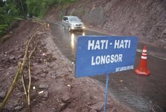 ASIAN COMMON DISASTER HANDLING PROCEDURE. A road that collapsed due to landslides in mountainous areas of Karanganyar, Central Java, Indonesia. Indonesia and 21 stock photo