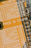 Asian computer part. Closeup of taiwanese computer motherboard fragment Royalty Free Stock Images