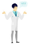 Asian confused doctor with spread arms. Royalty Free Stock Images