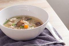 Asian congee with pork in white Stock Images