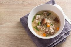 Asian congee with pork in white Royalty Free Stock Photos