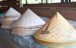 Asian conical wide-brimmed rain hats Stock Photography
