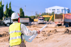 Asian construction engineer checking construction site stock photo
