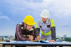 Asian construction engineer and his foreman working together loo royalty free stock photos