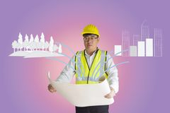 Asian construction engineer holding paper.Forest and building are drawn doodle lines.Concept of environmental balance. Royalty Free Stock Image