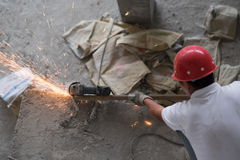 Asian Construction Worker Cutting Metal Sparks Stock Photos