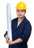 Asian construction worker holding layout drawing Royalty Free Stock Photo