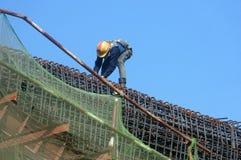 Asian construction worker, overhead railway, metro Royalty Free Stock Image