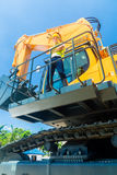 Asian construction worker on shovel excavator Royalty Free Stock Photos