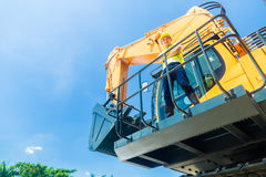 Asian construction worker on shovel excavator Stock Photography
