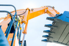 Asian construction worker on shovel excavator Royalty Free Stock Photography