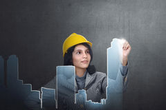 Asian constructor woman with safety helmet create urban planning Stock Photo