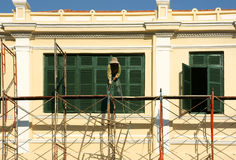 Asian contruction worker on scaffold Royalty Free Stock Image