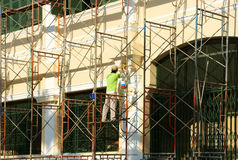 Asian contruction worker on scaffold Stock Image
