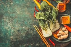 Asian cooking ingredients with Chopsticks on vintage background, top view. Place for text royalty free stock image