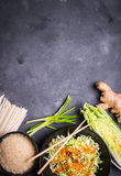 Asian cooking ingredients. Ingredients for making chinese dinner: wheat noodles, rice, napa cabbage, ginger, green onion. Asian cooking ingredients. Top view stock image