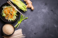 Asian cooking ingredients. Ingredients for making chinese dinner: wheat noodles, rice, napa cabbage, ginger, green onion. Asian cooking ingredients. Top view stock images