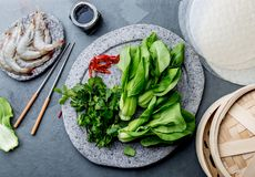 Asian cooking ingredients: rice papper, pok choy, sauces, raw shrimps. Asian food concept Chinese or Thai cuisine. Asian cooking ingredients: rice papper, pok stock photography
