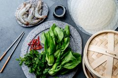 Asian cooking ingredients: rice papper, pok choy, sauces, raw shrimps. Asian food concept Chinese or Thai cuisine. Asian cooking ingredients: rice papper, pok royalty free stock photo