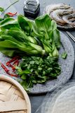 Asian cooking ingredients: rice papper, pok choy, sauces, raw shrimps. Asian food concept Chinese or Thai cuisine. Asian cooking ingredients: rice papper, pok royalty free stock photography