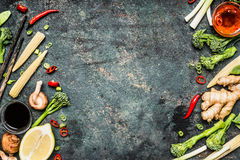 Asian cooking ingredients on rustic background. Fresh vegetables and spices for tasty Chinese or Thai  cooking Royalty Free Stock Photos