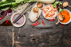 Asian cooking ingredients with soy and sweet-sour sauce and chopsticks on rustic background, top view Royalty Free Stock Photography