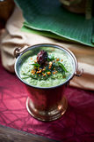 Asian Coriander and Chutney Dip. On an Indian settings Stock Images
