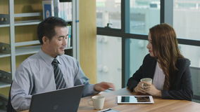 Asian corporate executive talking in office. Two asian corporate executives discussing business in office stock video